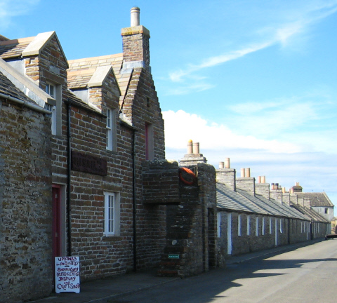 Shapinsay Heritage Centre and The Smithy - houses beyond were built for workers on the Balfour estate