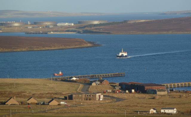 The Thorsvoe sailing between Fara on the left and Flotta on the right.