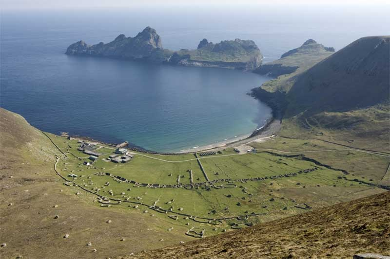 St Kilda village today, from the hills behind it, which are still grazed by Soay sheep.  The buildings to the left are the modern base.