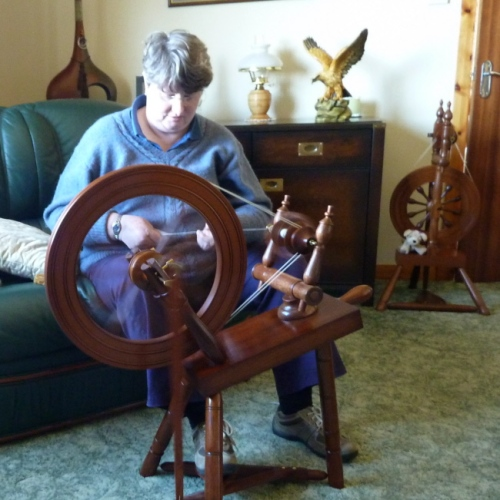 Jane trying her wheel in Granville's house.  Jean's wheel is in the background