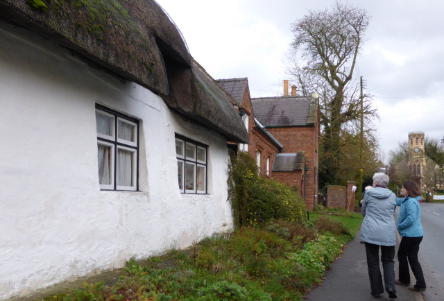 Thimbleby village.  Details of the architecture being explained to Mary Lou by Pauline