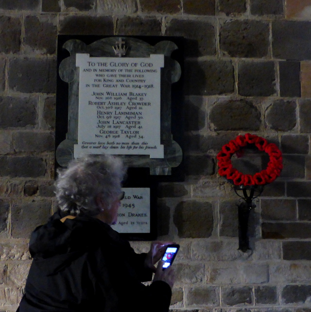 The war memorial which started the project with the knitted poppy wreath given to the church